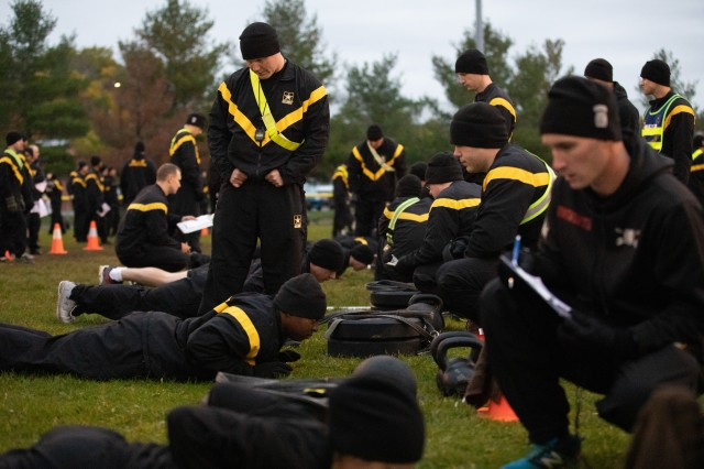 Soldiers with 1BCT10MTN conduct the Hand-Release Push-Up event in the new Army Combat Fitness Test (ACFT) at SSG Cool Memorial Ball Fields, Fort Drum, N.Y., Nov 1, 2018. (U.S. Army photo by SSG James Avery, 1BCT10MTN Public Affairs)