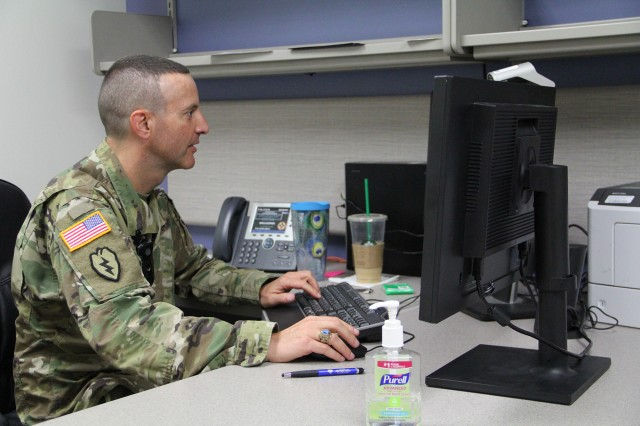 Col. Douglas Maurer, from Fort Sill's Health Readiness Center, administers a virtual periodic health examination for a Soldier at Fort Huachuca, Ariz. (Photo Credit: Joel McFarland)