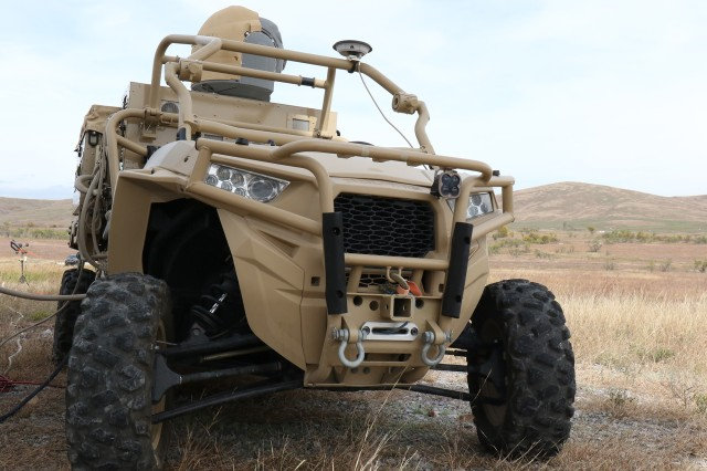 The High Energy Laser Weapon System, or HELWS, patrols during the Maneuver and Fires Integrated Experiment Oct. 30, 2018, at Fort Sill, to demonstrate its ability to search, track, engage, and destroy unmanned aerial vehicles.