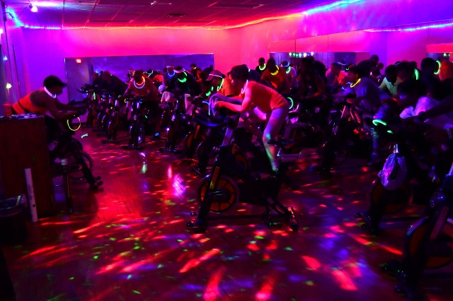 FORT KNOX, Kentucky -- Two dozen indoor cycling fans pedal to the beat of the music during a special Halloween workout session Oct. 31, 2018 led by volunteer fitness instructor Maj. Ronyel Sanders, who leads the group at Gammon Physical Fitness Center every Wednesday morning.