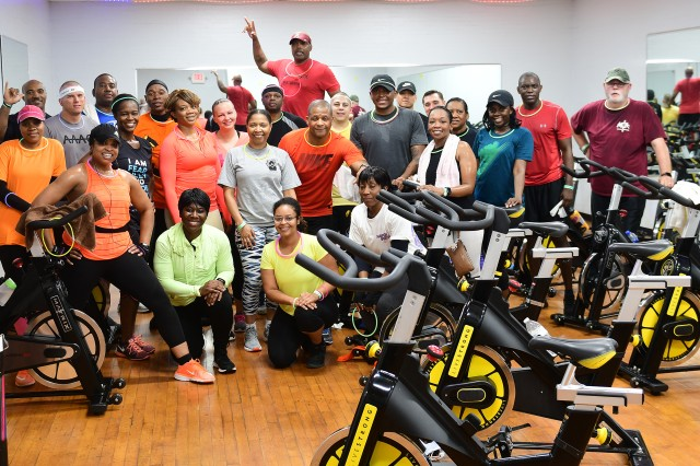 FORT KNOX, Kentucky -- Members of the Wednesday morning indoor cycling group celebrate after the Halloween exercise session.
