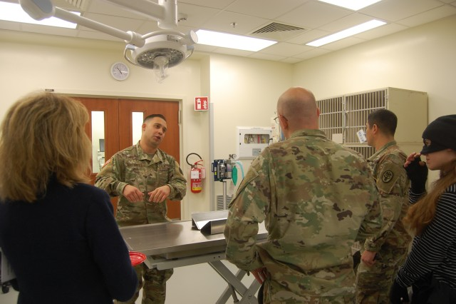 Sgt. Ivan Cervantes, an animal care NCO at the Vicenza Veterinary Clinic, shows guests the veterinary clinic's new surgery room and explains its various uses.