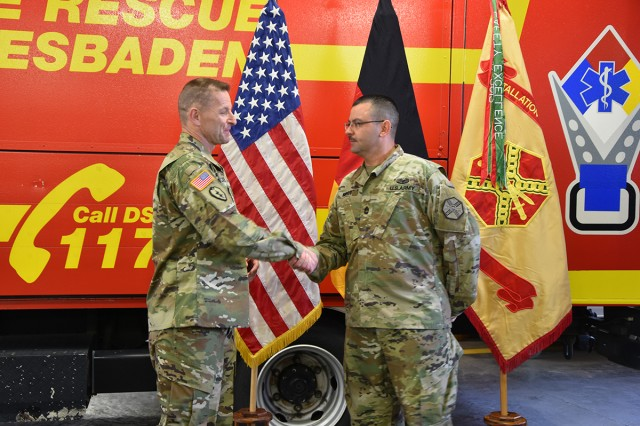 Installation Management Command Commanding General Lt. Gen. Bradley A. Becker presents a coin to Sgt. 1st Class Joseph S. Kirkey, NCOIC for U.S. Army Garrison Wiesbaden S3/5/7 during a visit to the garrison Oct. 29.