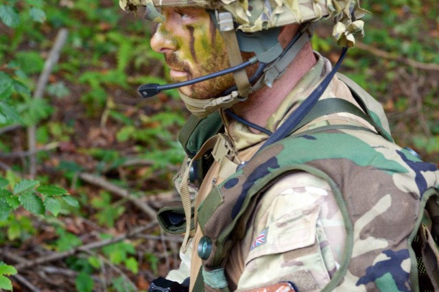 A United Kingdom soldier conducts a training exercise with the Deployable Instrumentation System Europe (DISE) provided by the 7th Army Training Command Training Support Division Expeditionary during the Triglav Star IV exercise, Bohinisja Bela, Slovenia , Sept. 18, 2018.  Exercise Triglav Star IV is an annual multinational Mountain Warfare Exercise hosted by the Slovenian Armed Forces in Bohinjska Bela, Slovenia and is an intense, two-week tactical exercise where Soldier from United Kingdom, and the 1-157 IN Colorado, and Slovenia demonstrate interoperability while performing unit tactics in the Julian Alps.