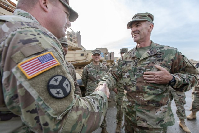 U.S. Army Maj. Gen. John Gronski, U.S. Army Europe's Deputy Commanding General, meet with Soldiers assigned to Battle Group Poland during a visit to Bemowo Piskie Training Area, Poland, Oct. 30.