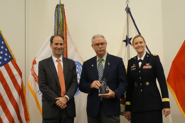 Steve Rowley, Fort Drum energy manager, receives a Secretary of the Army Energy and Water Management award for exceptional service from Jordan Gillis, acting assistant Secretary of the Army for Installations, Energy and Environment; and Brig. Gen. Joy L. Curriera, director of operations for the Assistant Chief of Staff for Installation Management. (Courtesy Photo)