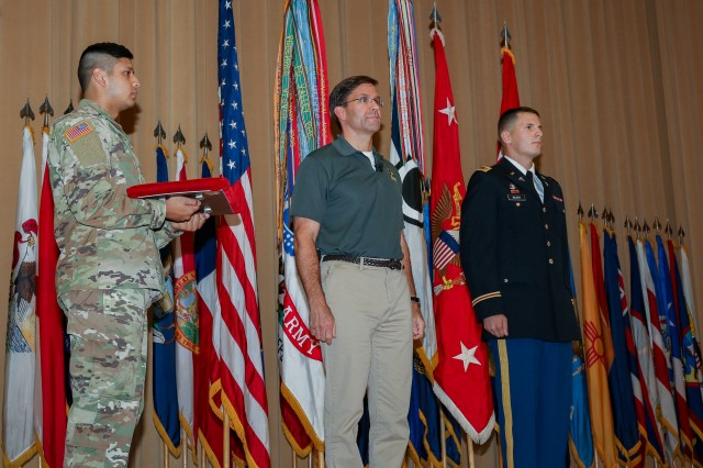 2nd Lt. Robert McCoy an Army medical service officer assigned to the 56th Multifunctional Medical Battalion, 62nd Medical Brigade, receives the Soldier's Medal Thursday from Dr. Mark T. Esper, Secretary of the Army, for his acts of heroism after the 2017 Amtrak train derailment.