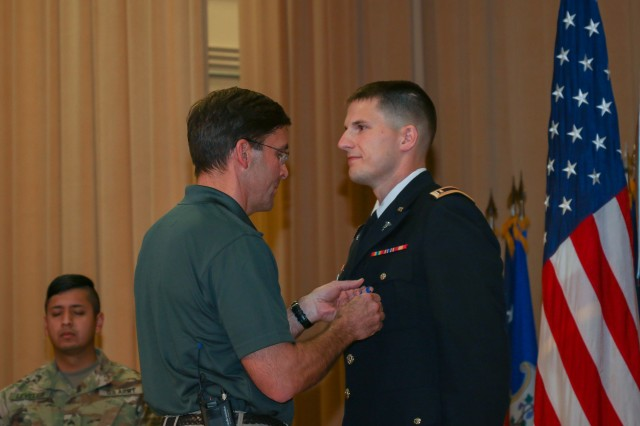 Secretary of the Army Dr. Mark T. Esper pins the Soldier's Medal, the Army's most prestigious peacetime award for valor, on 2nd Lt. Robert McCoy, a native of Walters, Oklahoma, Thursday for his acts of heroism during the Amtrak derailment 10 miles from Joint Base Lewis McChord, Washington Dec. 18, 2017.