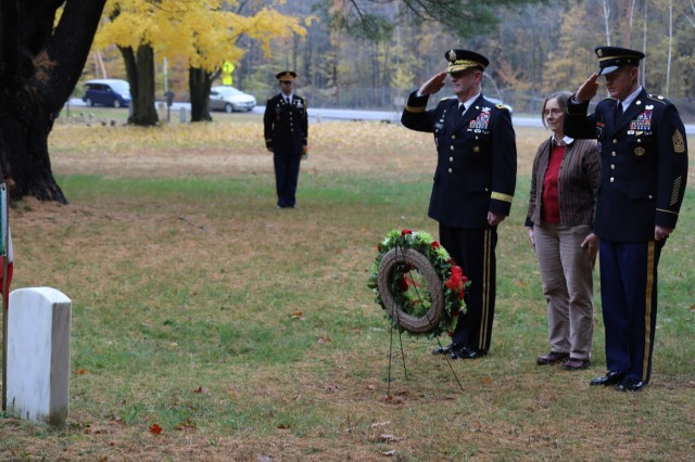 Maj. Gen. Walter E. Piatt, 10th Mountain Division (LI) and Fort Drum commander, Command Sgt. Maj. Samuel J. Roark, 10th Mountain Division (LI) and Fort Drum senior enlisted adviser, and Dr. Laurie Rush, Fort Drum Cultural Resources manager, placed a wreath Nov. 2 at the grave of an Italian soldier buried at the Prisoner of War (POW) Cemetery at Fort Drum, New York. (Photo by Staff Sgt. Michael Reinsch, 10th Mountain Division (LI) Public Affairs)