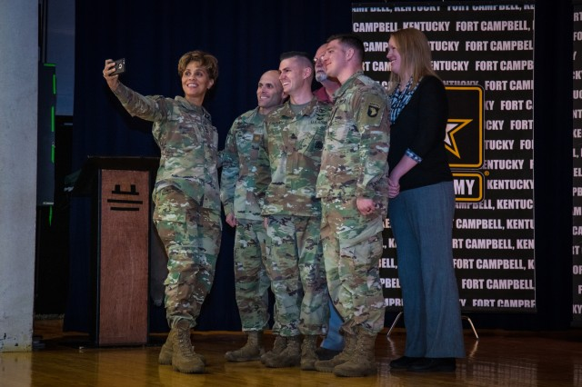 At a Fort Campbell community town hall, Lt. Gen. Nadja West, U.S. Army surgeon general and commander of Army Medical Command, takes a selfie with Soldiers and Army Civilians after presenting coins for individual accomplishments, Oct. 30, 2018.