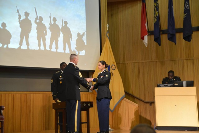 FORT LEE, Virginia - U.S Army Cpl. Hala Kadhem, a unit supply specialist assigned to the 2nd Infantry Brigade Combat Team, 4th Infantry Division, receives her diploma after graduating from Advanced Individual Training at Fort Lee, Virginia. (Courtesy photo)