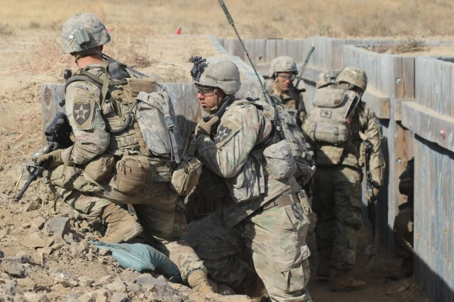 Soldiers from 2nd Battalion, 1st Infantry Regiment, 2nd Stryker Brigade Combat Team, 2nd Infantry Division clear a trench during a Combined Arms Maneuver Live Fire Exercise at Yakima Training Center, Wash.,  Oct. 3, 2018.