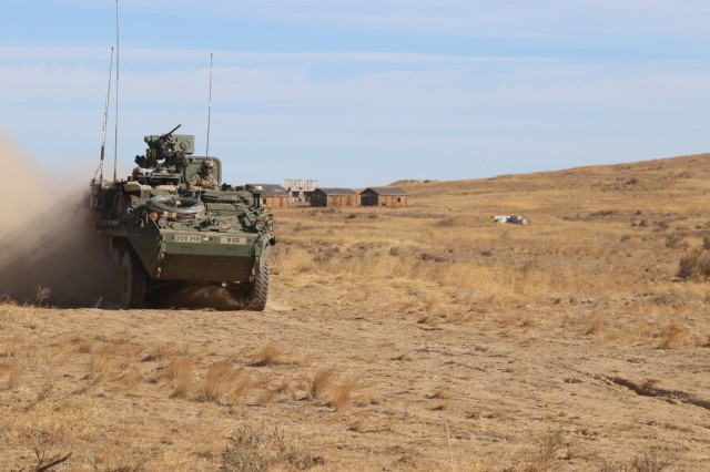 Soldiers from 2nd Battalion, 1st Infantry Regiment, 2nd Stryker Brigade Combat Team, 2nd Infantry Division maneuver their Stryker during a Combined Arms Maneuver Live Fire Exercise at Yakima Training Center, Wash., Oct. 3, 2018. Stryker's enables Soldiers to maneuver in close and urban terrain, provide protection in open terrain and transport quickly to battlefield positions