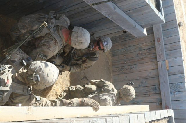 Soldiers from 2nd Battalion, 1st Infantry Regiment, 2nd Stryker Brigade Combat Team, 2nd Infantry Division clear a trench during a Combined Arms Maneuver Live Fire Exercise at Yakima Training Center, Wash.,  Oct. 3, 2018. The Army's first priority is Readiness, ensuring that our Soldiers have the tools and training they need to be lethal and ready.