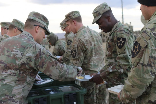 Soldiers from 2nd Stryker Brigade Combat Team, 2nd Infantry Division  enjoy a hot meal during a Combined Arms Maneuver Live Fire Exercise at Yakima Training Center, Wash., Oct. 1, 2018. The CAMLFX develops lethal companies in preparation for Bayonet Focus 19-01 and a rotation to the National Training Center, Fort Irwin, Calif.