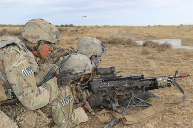 A 2nd Battalion, 1st Infantry Regiment 2nd Stryker Brigade Combat Team, 2nd Infantry Division, RTO (radiotelephone operator) communicates with his team during a Combined Arms Maneuver Live Fire Exercise at Yakima Training Center, Wash., Oct. 1, 2018. CAMLFX's maintain a units Readiness to fight and win our nation's wars when called upon.