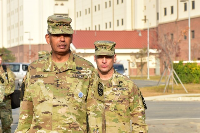 CAMP HUMPHREYS, Republic of Korea -- Gen. Vincent K. Brooks, Anchorage, Alaska native, and commanding general, United Nations Command/Combined Forces Command/United States Force Korea, and Maj. Gen. D. Scott McKean, San Jose, California native, and commanding general, 2nd Infantry Division/ROK-U.S. Combined Division, arrive at the 2ID Regimental Walk Ceremony to unveil the 9th Infantry Regiment stone marker at the new division headquarters Nov. 5. Brooks served as former commander of 2nd Battalion, 9th Infantry (Manchu) Regiment and dedicated the first marker, demonstrating his connection to past Warriors.