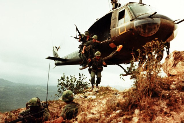 A reconnaissance platoon from the 1st Air Cavalry Division exits a UH-1D Huey helicopter in Du Pho, South Vietnam in 1967.