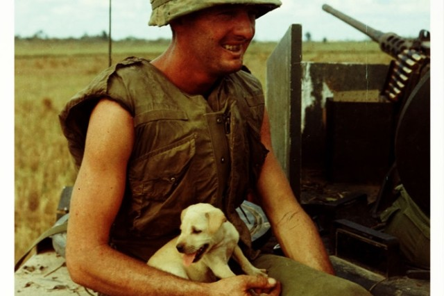 Pfc. Fred. L. Greenleaf with a puppy at Cat Lai, South Vietnam in 1967.