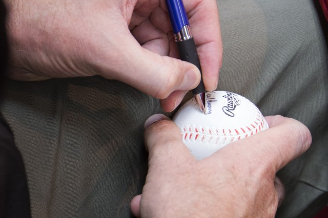 Randy Johnson autographs a baseball for a fan during a meet-and-greet Nov. 4 at the Camp Zama Exchange. Johnson was at the installation as part of a visit with the USO; he previously visited Camp Zama in 2011.