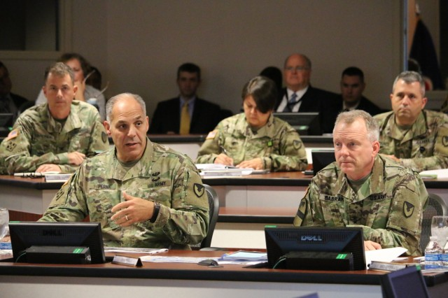 Gen. Gus Perna, commander of the Army Materiel Command, outlines priorities and expectations during the Aviation and Missile Command Quarterly Update Oct. 26. To Perna's left is AMCOM commander Maj. Gen. Doug Gabram. U.S. Army Photo by Traci Boutwell.