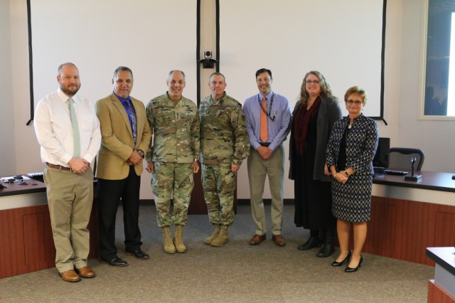 The Army Materiel Command's Gen. Gus Perna and Command Sgt. Maj. Rodger Mansker with a few of the Aviation and Missile Command's top employees during the AMCOM Update Oct. 26. The employees are, from left, Matt Merritt, Rudy Flores, Scottie Smith, Jessica Dunaway and Marsha Bailey. They were recognized for their efforts to ensuring AMCOM mission readiness. U.S. Photo by Traci Boutwell.