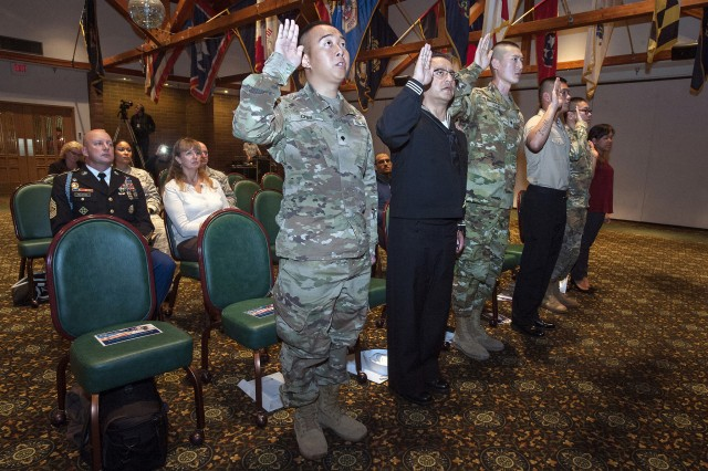 Five service members and a military spouse take the oath of allegiance during the ninth annual Naturalization Ceremony at the Club at McChord Field Nov. 9, 2016.