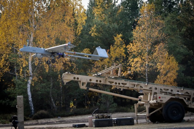 An RQ-7B Shadow tactical unmanned aircraft system, controlled and maintained by Soldiers assigned to Delta Company, 91st Brigade Engineer Battalion, 1st Armored Brigade Combat Team, 1st Cavalry Division, launches from a ramp at Horsemen Flight Landing Strip in Trzebien, Poland, Nov. 1, 2018.