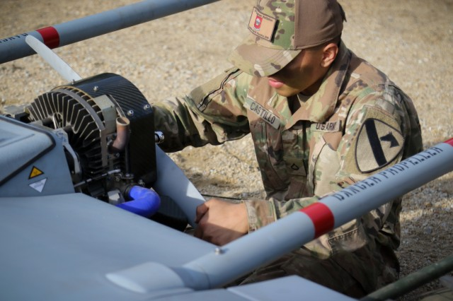 U.S. Army Pfc. Carlos Castillo, an unmanned aircraft systems repairer, assigned to Delta Company, 91st Brigade Engineer Battalion, 1st Armored Brigade Combat Team, 1st Cavalry Division, performs post-flight maintenance and repairs on an RQ-7B Shadow tactical unmanned aircraft system at Horsemen Flight Landing Strip in Trzebien, Poland, Nov. 1, 2018.