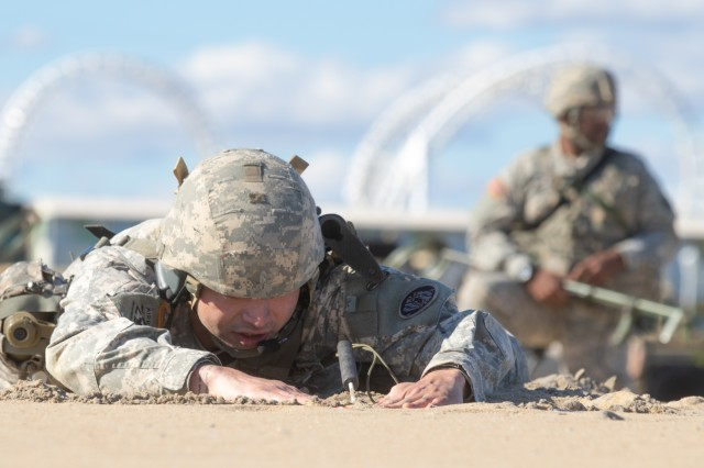 A Soldier from the 253rd Engineer Company, probes an area looking for a simulated mine hidden during a domestic emergency response exercise at Ocean City, Maryland on Nov. 3, 2018. Maryland National Guard Soldiers, as well as, Ocean City emergency responders participated in a series of notational domestic emergency scenarios.