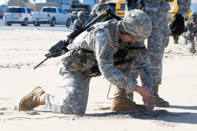 A Soldier from the 253rd Engineer Company, shows a wire found on the beach, while looking for a simulated mine hidden during a domestic emergency response exercise at Ocean City, Maryland on Nov. 3, 2018. Maryland National Guard Soldiers, as well as, Ocean City emergency responders participated in a series of notational domestic emergency scenarios.