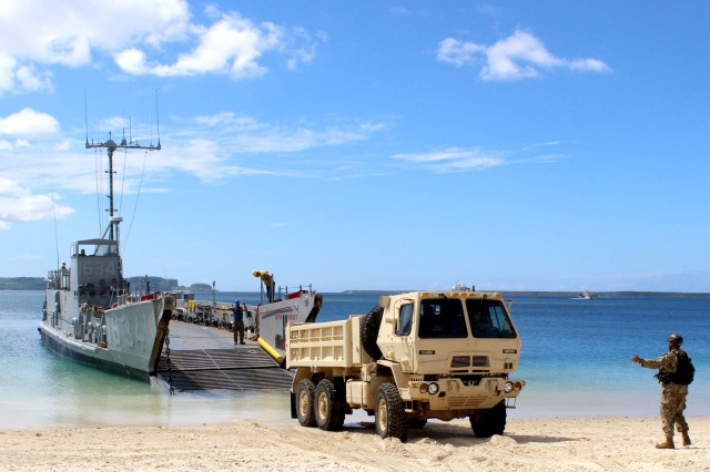 Sailors assigned to Naval Beach Unit (NBU) 7, load a 10-ton dump truck from the 1224th Engineering Support Company, Guam Army National Guard, onto Navy Landing Craft, Utility (LCU) 1634 at the Reserve Craft Beach in Guam. NBU-7 and Guam Army National Guard work to together to load 18 heavy equipment vehicles onto the Whidbey-Island class amphibious dock landing ship USS Ashland (LSD 48). Ashland is at Naval Base Guam to transport heavy equipment vehicles to Saipan in support of disaster relief efforts after Super Typhoon Yutu.
