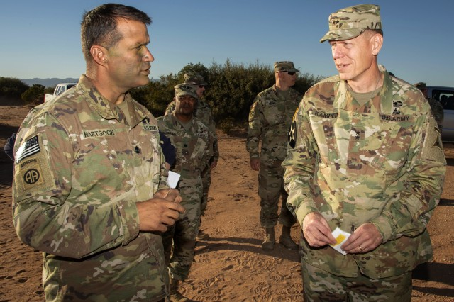 Lt. Col. Jonathan T. Hartsock (left), commander of the 5th Squadron, 73rd Cavalry Regiment, an airborne reconnaissance squadron in the 3rd Brigade Combat Team of the 82nd Airborne Division from Fort Bragg, N.C., talks with Maj. Gen. Kenneth L. Kamper, deputy commander for maneuver for III Corps and Fort Hood, Texas, about battlefield communications systems during Network Integration Evaluation 18.2. NIE at Camp McGregor, N.M. NIE 18.2 is a Soldier-led evaluation exercise designed to integrate and rapidly progress the Army's battlefield communications network, and support the Network Cross Functional Team's modernization efforts. The 3rd Brigade (ABN), 82nd Airborne Division is the rotational unit testing the Army's communications backbone during NIE 18.2, which runs through Nov. 12. Kamper was on hand at NIE 18.2 making sure Soldiers operating the Army's battlefield communication system backbone are trained and ready with the best equipment.