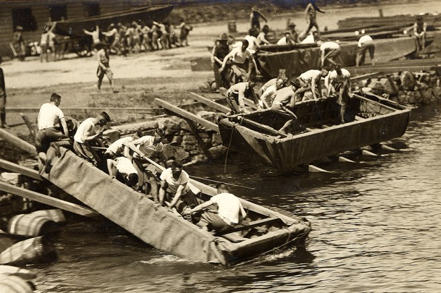 West Point cadets move pontoon boats offshore and into the Hudson River during training in July 1918.