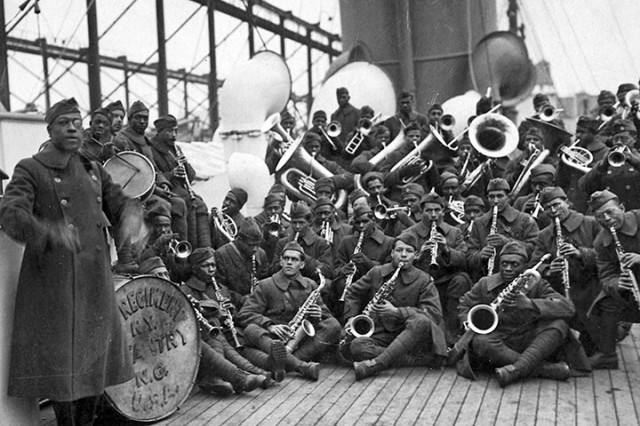 Lt. James Reese Europe, band director, far left, poses the jazz band of the 369th Infantry Regiment on the way home from war. Many music historians credit the music of the 369th for laying the foundation for the popularity of jazz music in France after the end of World War I.