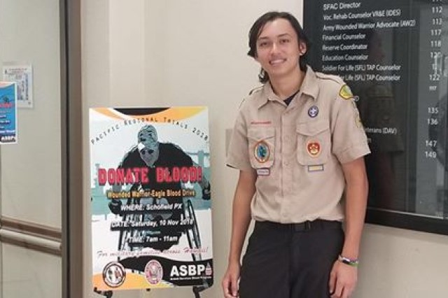Eagle Scout Candidate, Kai Guzior displays posters, Nov. 4, at Warrior Transition Battalion-Hawaii, to promote the upcoming Wounded Warrior - Eagle Scout Blood Drive.  The blood drive is scheduled on Nov. 10, 7:00 a.m. until 11:00 a.m. at the Schofield Barracks Post Exchange. Guzior chose a wounded warrior blood drive for his Eagle project which requires a scout to demonstrate leadership skills that benefit the community. This event coincides with the 2018 Pacific Regional Trials, adaptive sports competition for wounded warriors and Warrior Care Month.