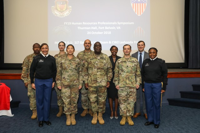 Organizers and presenters of the first U.S. Army Intelligence and Security Command (INSCOM) Human Resources (HR) Professionals Symposium gather for a group photo prior to the event beginning at Thurman Hall, Oct. 24.