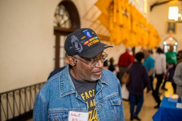 FORT BENNING, Ga. (Nov. 7, 2018) - Retired E-4 Herbert McDuffie visits several tables during Fort Benning's Retirement Appreciation Day event. Veterans of the U.S. military from Georgia and Alabama attended the annual Retiree Appreciation Day event Nov. 2 and the Benning Club at Fort Benning, Georgia. The event provides retirees and their Family members the information on policy updates, the opportunity to network with one another, the chance to renew ID cards, receive medical checkups, and more. (U.S. Army photo by Patrick Albright, Maneuver Center of Excellence, Fort Benning Public Affairs)