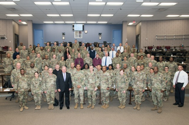 Attendees at the FORSCOM G-1 Manning Conference, hosted by the Army Human Resources Command at Fort Knox, Ky. Oct. 29- Nov. 1 pose for a group photo prior to discussion. Senior leaders from FORSCOM, HRC, HQDA G-1 and others met  those four days to collaborate on challenges that affect predictability and optimization of manning a sustainable force. ( U.S. Army photo photo By Charles Leffler)