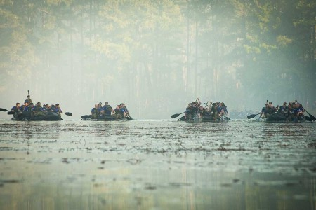 Paratroopers assigned to the 307th Airborne Engineer Battalion, 3rd Brigade Combat Team, 82nd Airborne Division, row Zodiac boats across Fort Bragg's McKellar's Pond on Wednesday, October 3, 2018 in commemoration of the 74th anniversary of the WWII Waal River Crossing.  The paratroopers were competing to cross the lake five times in honor of Pfc. Willard Jenkins, killed by enemy fire while manning a rudder during the river assault.