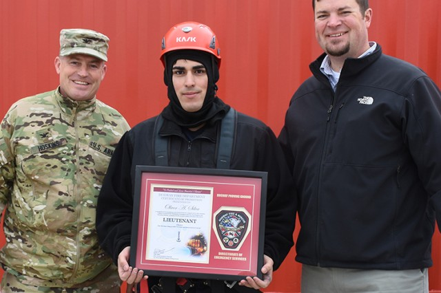 181009-A-BB276-009 The opportunity was taken to publicly recognize Firefighter Oliver Silva Oct. 9, 2018 at Dugway Proving Ground, Utah, during Firefighter Skills Day for his promotion to lieutenant. Left: Col. Brant Hoskins, commander of Dugway Proving Ground. Right: Garrison Manager Aaron Goodman. Photo by Al Vogel, Dugway Proving Ground Public Affairs
