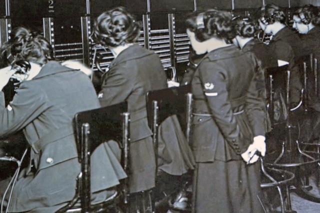 Mobile telephone operators of the U.S. Army Signal Corps operate a switchboard at a headquarters in France during 1918.