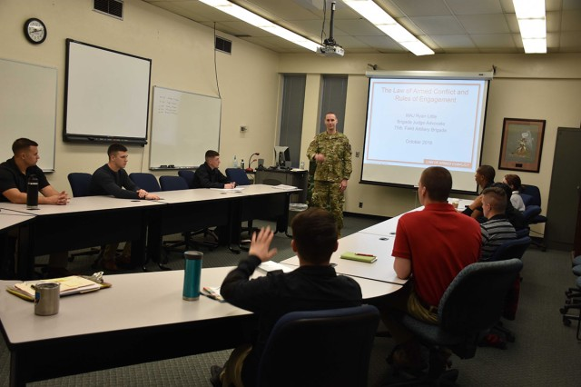 75th Field Artillery Brigade Judge Advocate Maj. Ryan Little, gives a class to Cameron University ROTC cadets, who are in their senior year. The class on military law of armed conflict and rules of engagement provided useful knowledge to the future Army leaders.