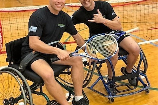 "Regional Health Command - Atlantic teammates Sgt. 1st Class Shannon McLimans and Sgt. Johnathan Weasner celebrate their 2018 Pacific Regional Trials wheelchair tennis victory with McLimans showing the Hawaiian ""shaka"" November 6, 2018.  These competitions take place during November, which also coincides with Warrior Care Month. During Warrior Care Month we focus on activities that allow us to communicate the Army's commitment to wounded, ill, and injured soldiers, their families, and caregivers, and to emphasize Warrior Transition Unit Soldiers' number one priority is to work as hard on their recovery as they work on defending the nation."