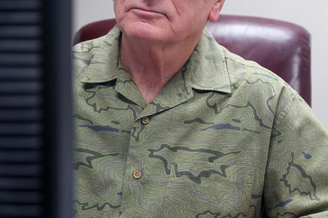 Ray Jude, Fort Sill Installation Traffic manager, sits at his desk in Bldg. 4700, Oct. 18, 2018. He completed 50 years of federal service in August, which included 27 years active-duty Army with two tours in Vietnam.