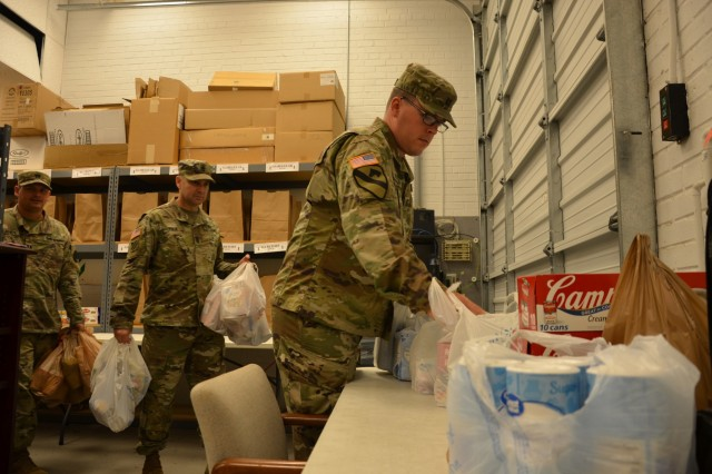 FORT BENNING, Ga. (Nov. 8, 2018) - The 3rd Battalion, 81st Armored Regiment, held a food drive for the Battle Buddy Resource Center at Fort Benning, Georgia, delivering non-perishable goods to the center Nov. 8, 2018. (U.S. Army photo by Bryan Gatchell, Maneuver Center of Excellence, Fort Benning Public Affairs)