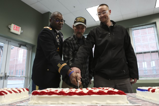 Watervliet Arsenal commander Col. Milton Kelly, left, cuts the service cake with workforce veterans Dave Orourke, middle, and Will Tharp during a tradition cake-cutting veterans recognition ceremony on Nov. 8.