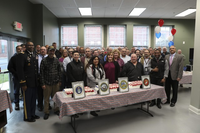 Watervliet Arsenal commander Col. Milton Kelly poses with veteran members of the arsenal's civilian workforce during a ceremony recognizing their service and contributions to the arsenal on Nov. 8.