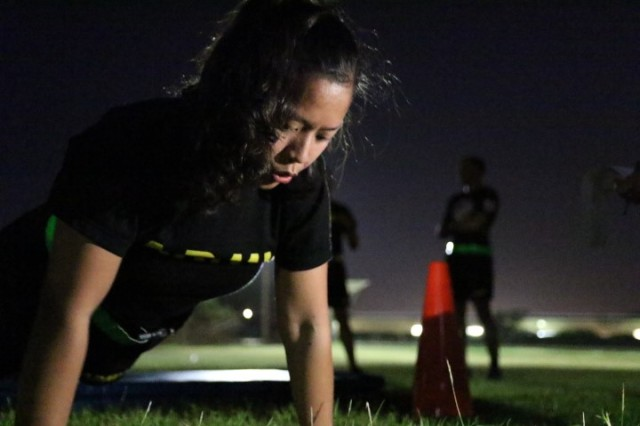 Sgt. Mariecrista Hines, HHC, 8th STB, 8th Theater Sustainment Command, takes a deep breath between pushups during the Army Physical Fitness Test at Fort Shafter Flats, Hi.  Hines is one of six competitors that competed for Soldier of the Year in this year's 8th Support Troops Battalion NCO, Soldier of the Year Competition