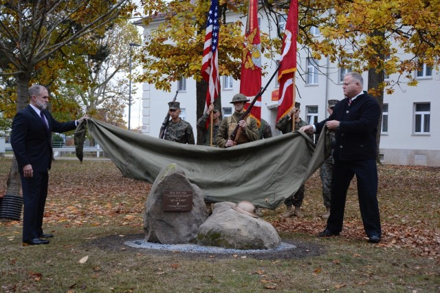 The tarp is lifted to unveil the stones, plaque and WW I USMC doughboy helmet, dedicating the MARFOREUR/AF parade ground as 'Devil Dog Field,' Nov. 8.